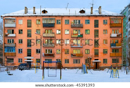 facade of the old  house photographed in winter - stock photo