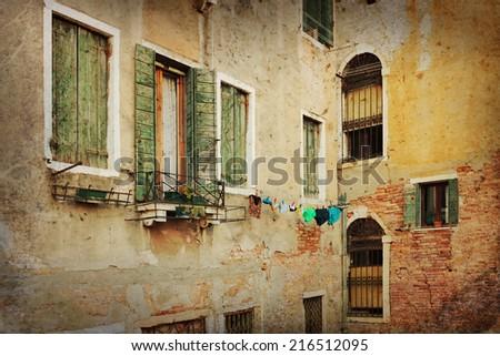 Facade of the old Italian house in Venice - stock photo