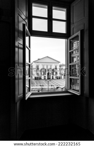 Facade of the theater of Mortara, through an open window. BW image - stock photo