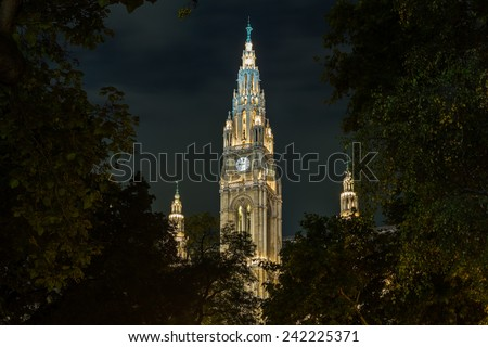 Facade of the town hall or Rathaus illuminated at night in Vienna, Austria - stock photo