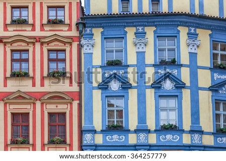 Facade of two colorful ornate houses in Prague, Czech Republic. - stock photo