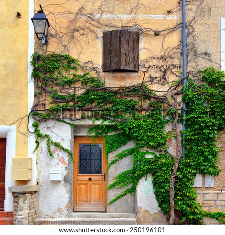 Facade of typical building in small old village of Mazan, Provence, France. - stock photo