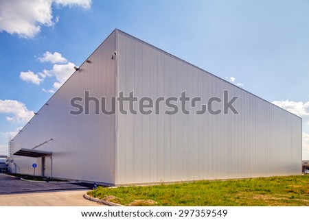 Facade on large industrial building made of aluminum panels - stock photo