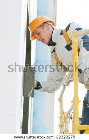 facade thermal insulation works with stopping and surfacer - stock photo