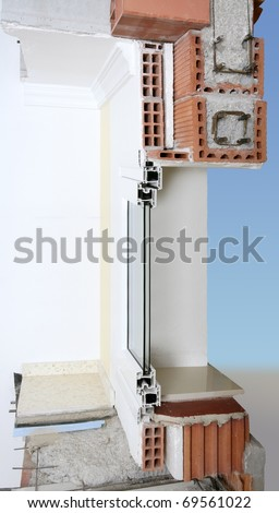 facade wall cross section of brick blocks window structure roof and floor slab [Photo Illustration] - stock photo