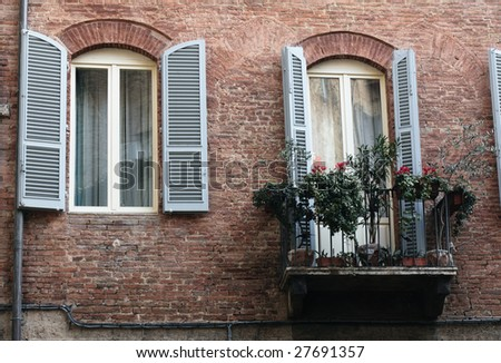 Facade with balcony, Siena - stock photo