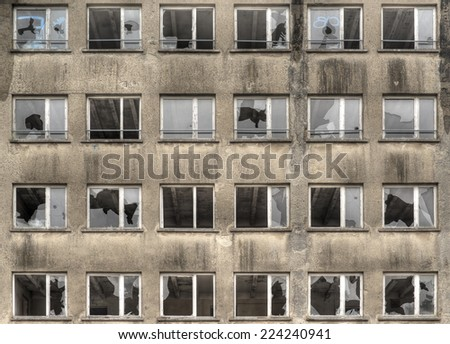 facade with broken windows of a historical abandoned building from nazi era in Germany, Prora, Rugia Island, HDR image - stock photo
