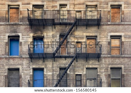 Facade with fire rescue of an old house in New York - stock photo