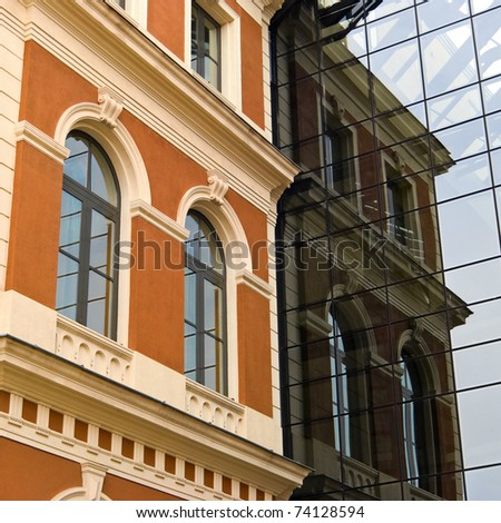 Facades of buildings from different eras - stock photo