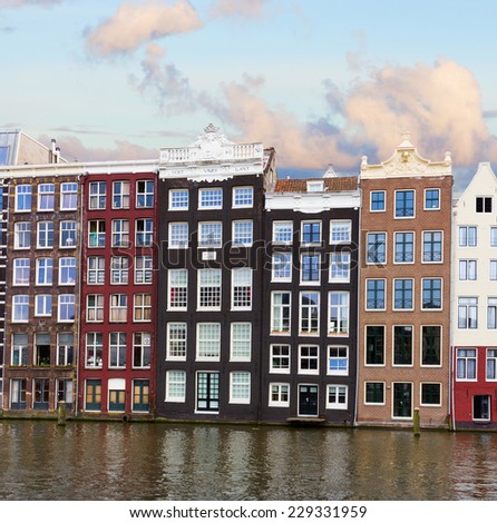 facades of historic buildings over canal waters, Amsterdam, Netherlands - stock photo