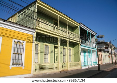 Facades of houses in the Calle Baquedano in the typical architecture style of Iquique, North Chile, South America - stock photo