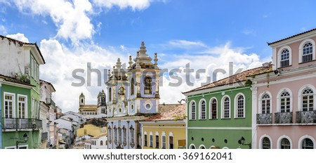 Facades of the old houses and townhouses and towers of historic churches in Pelourinho neighborhood in Salvador, Bahia - stock photo