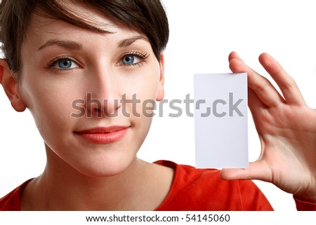 face and hand of beautiful girl holding an empty card - stock photo