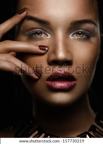 Face and hand with red nails. - stock photo