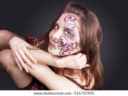 Face Art Project: Sexy Caucasian Brunette Woman In Corset Painted With Unique Face Art Painting.Against Black Background. Horizontal Image Orientation - stock photo
