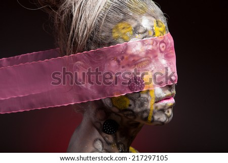 face art woman close up portrait with pink veil - stock photo