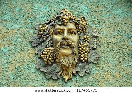 Face artwork on retro concrete wall - stock photo