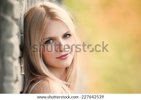 face beautiful fun cheerful smiling blonde girl with blue eyes lifestyle  healthy  retro outdoors emotions  environment fresh - stock photo
