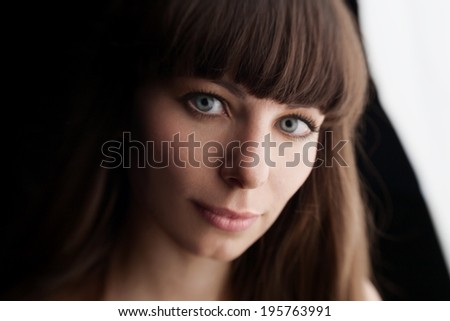 face beautiful woman with dark hair and gray eyes