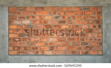 Face brick wall section, surrounded with plastered cement border. Can be used as textured background. - stock photo