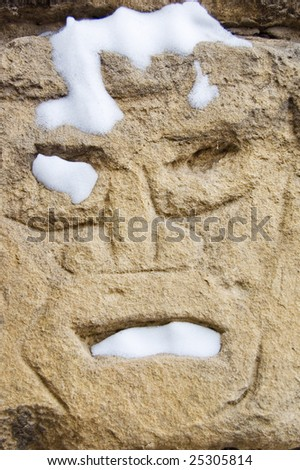 Face carved in stone - stock photo
