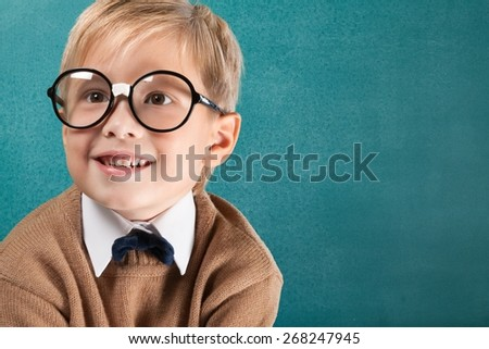 Face. Cheerful smiling boy on a green background. - stock photo