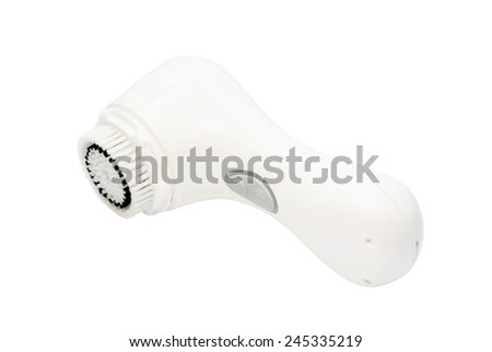 Face cleansing brush isolated on white. - stock photo