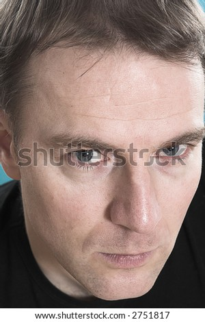 face close up of a man over blue background