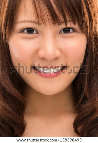 Face closeup of stunning beautiful mixed Chinese Asian woman. Isolated on white background. - stock photo