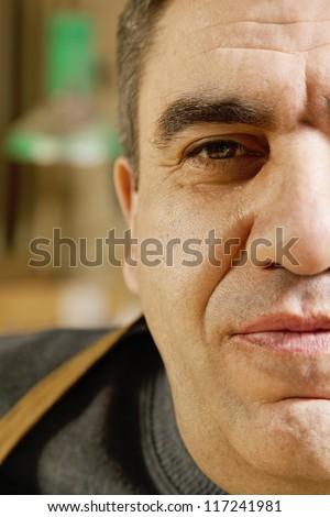 Face closeup portrait of middle-aged caucasian man - stock photo