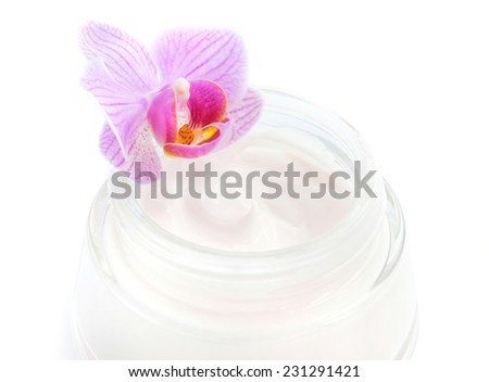 Face cream and beautiful orchid flower on white background - stock photo