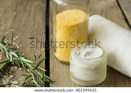 Face cream and jar with nath salt selective focus - stock photo