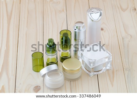 face cream box and cosmetics bottle on wood background -Collection of skincare spa products, Beauty concept - stock photo