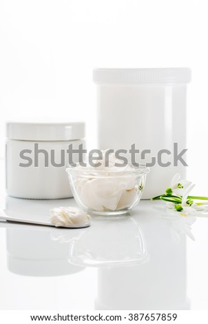 face cream on white wooden table - stock photo