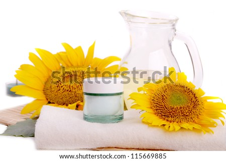 Face cream with sunflowers and oil isolated on white background