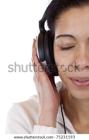 Face cut of a woman listening with joy to mp3 music. Isolated on white background. - stock photo