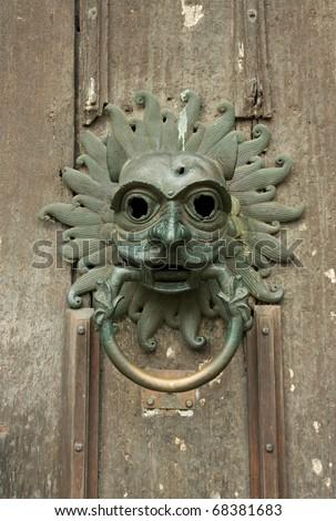 Face door knocker - stock photo