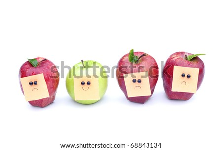 face expression on apples - stock photo
