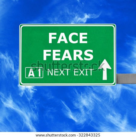 FACE FEARS road sign against clear blue sky - stock photo