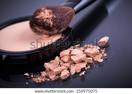 Face foundation powder product with crumbled texture - stock photo