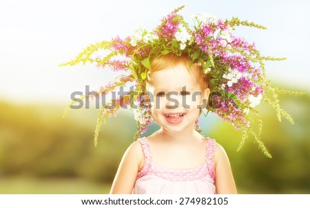 face happy little baby girl child in summer wreath - stock photo