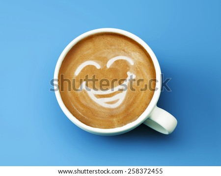 Face Laughing Coffee Cup Concept isolated on cyan background - stock photo