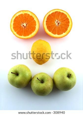 face-like arrangement of fruits - stock photo
