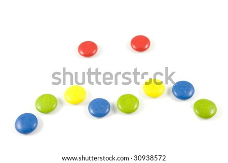 face made of colored smarties, isolated over white background
