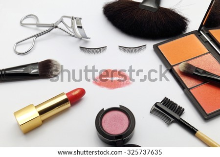 face make of fake eyelash and lipstick kiss with makeup products frame