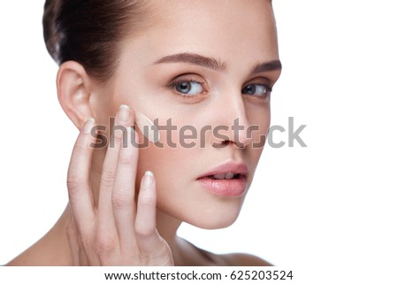 Face Makeup. Closeup Of Beautiful Sexy Woman Hand Applying Foundation On Facial Skin. Portrait Of Attractive Young Female Model With Fresh Makeup And Perfect Skin. Beauty Cosmetics. High Resolution