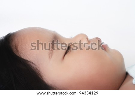 Face of a baby sleeping, profile view - stock photo