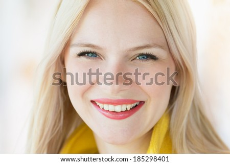 face of a beautiful blonde girl with blue eyes