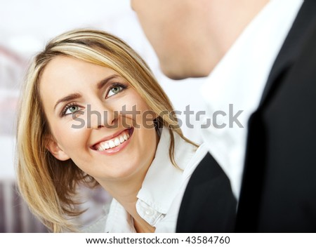 Face of a beautiful white collar female worker smiling at her partner