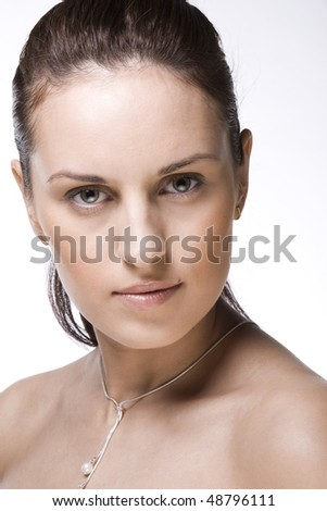 Face of a beautiful woman isolatetd on white - stock photo
